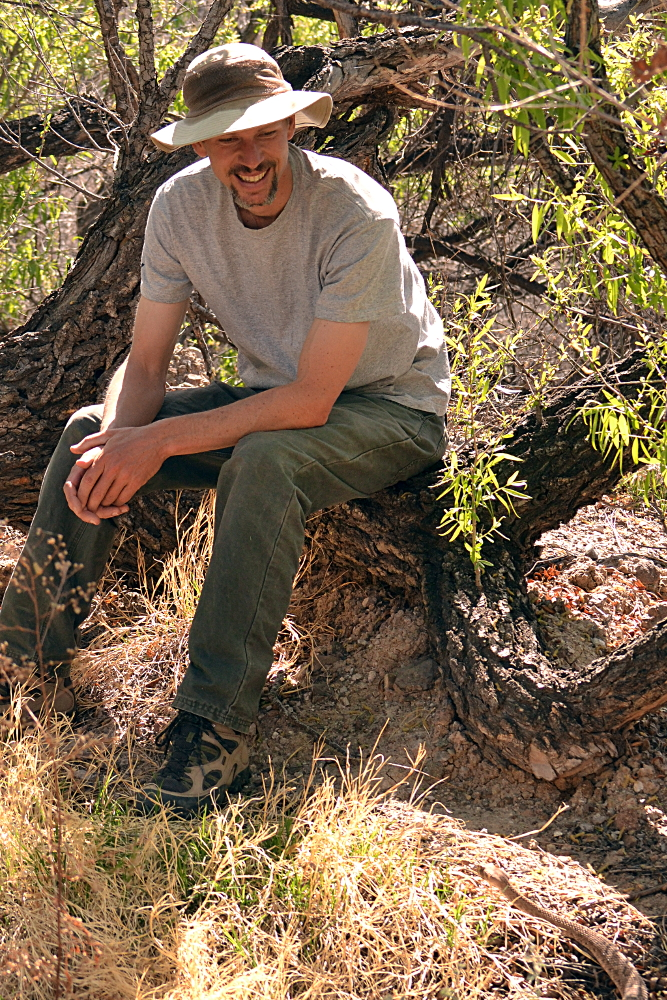 Jeff Smith admires Henry, Western Diamond-backed Rattlesnake.